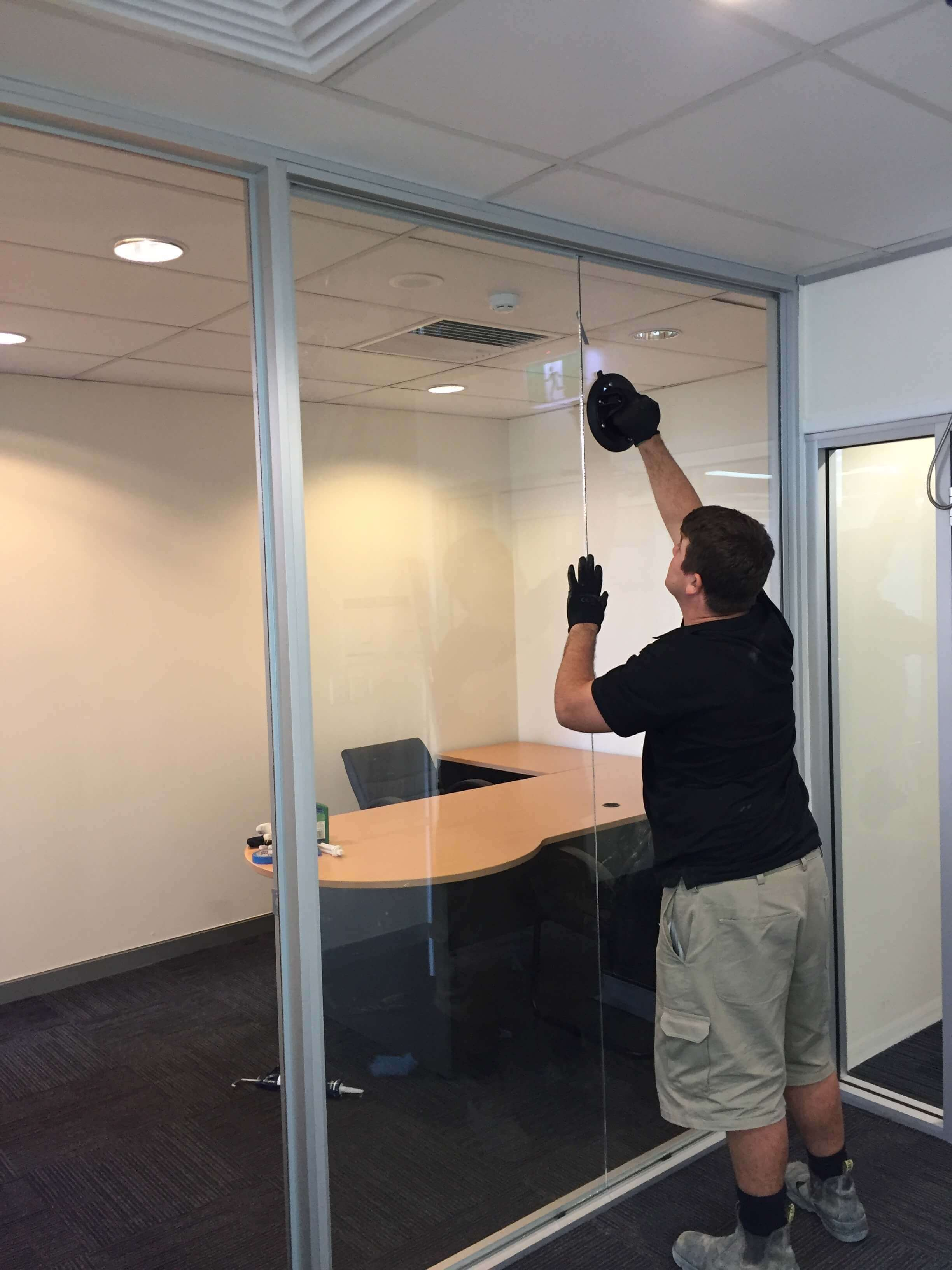 Glass Partitions being installed by Otal Constructions